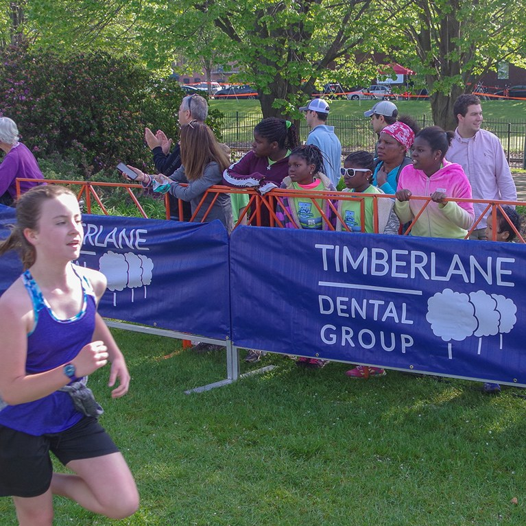A Girl running past spectators