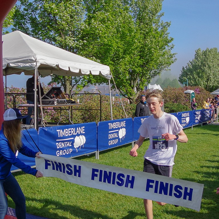 Youth crossing the finish line during race