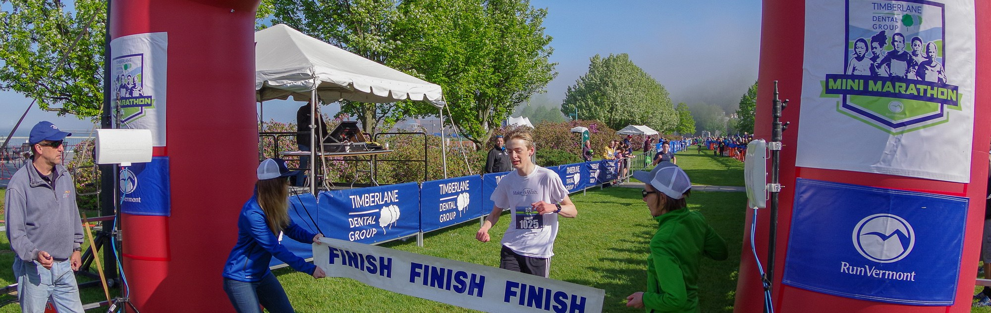 a Boy crossing the finish line