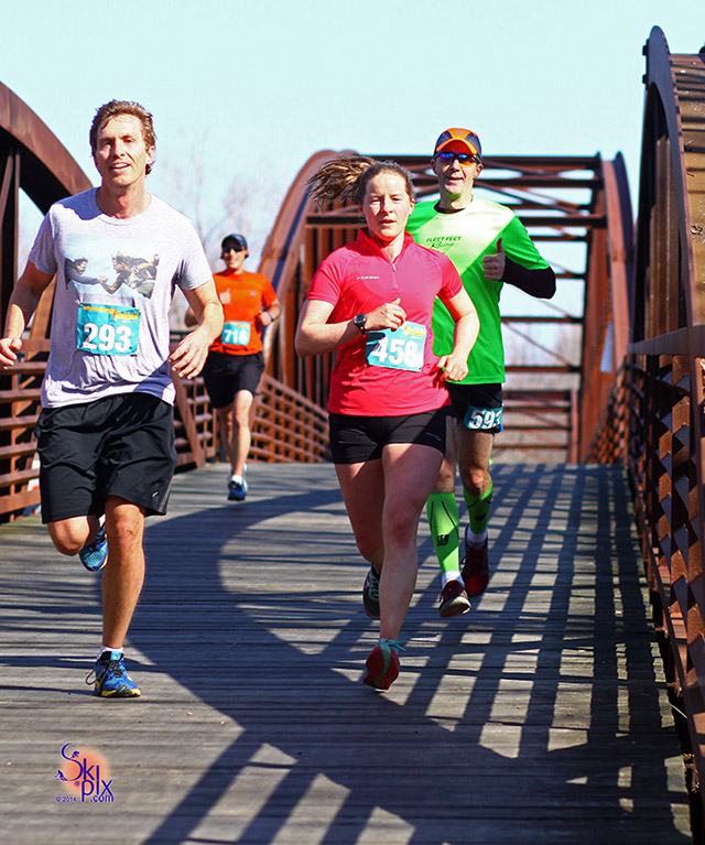 Runners crossing bridge during the Half Marathon Unplugged