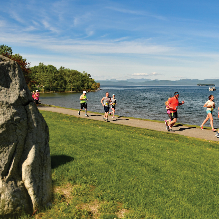 Runners passing Mini Stonhenge